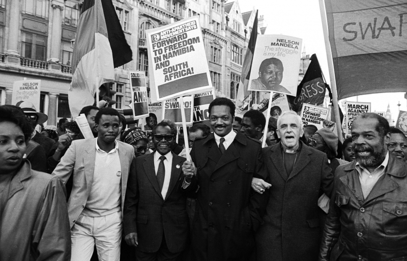 1985: Anti-Apartheid Rally: Tambo, Jackson & Huddleston