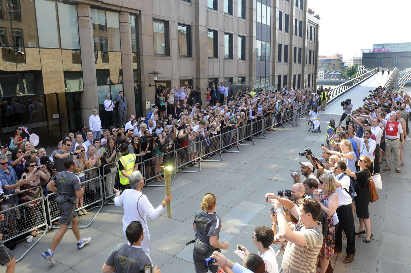 Enthusiastic crowds greet the Olympic Torch Relay as it is carried on to the north side of the Millennium Bridge in central London before being taken by a new torch bearer across the River Thames to south London© Stefano Cagnoni - reportdigital.co.uk01789 262151 07831 121483info@reportdigital.co.ukwww.reportdigital.co.ukNUJ recommended terms & conditions apply. Moral rights asserted under Copyright Designs & Patents Act 1988. No part of this photo to be stored, reproduced, manipulated or transmitted by any means without permission.
