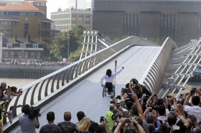 Enthusiastic crowds greet the Olympic Torch Relay as a new torch bearer  sets off across the Millennium Bridge across the River Thames to south London. On the other side another huge crowd can be seen waiting to greet him.© Stefano Cagnoni - reportdigital.co.uk01789 262151 07831 121483info@reportdigital.co.ukwww.reportdigital.co.ukNUJ recommended terms & conditions apply. Moral rights asserted under Copyright Designs & Patents Act 1988. No part of this photo to be stored, reproduced, manipulated or transmitted by any means without permission.