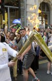 Enthusiastic crowds greet the Olympic Torch Relay as it passes through Islington in central London. The 'kissing point' as the flame passes from one torch to the next beofre the relay runner sets off.© Stefano Cagnoni - reportdigital.co.uk01789 262151 07831 121483info@reportdigital.co.ukwww.reportdigital.co.ukNUJ recommended terms & conditions apply. Moral rights asserted under Copyright Designs & Patents Act 1988. No part of this photo to be stored, reproduced, manipulated or transmitted by any means without permission.